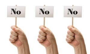 Three Signs In Male Fists Saying No, No and No Isolated on a White Background.